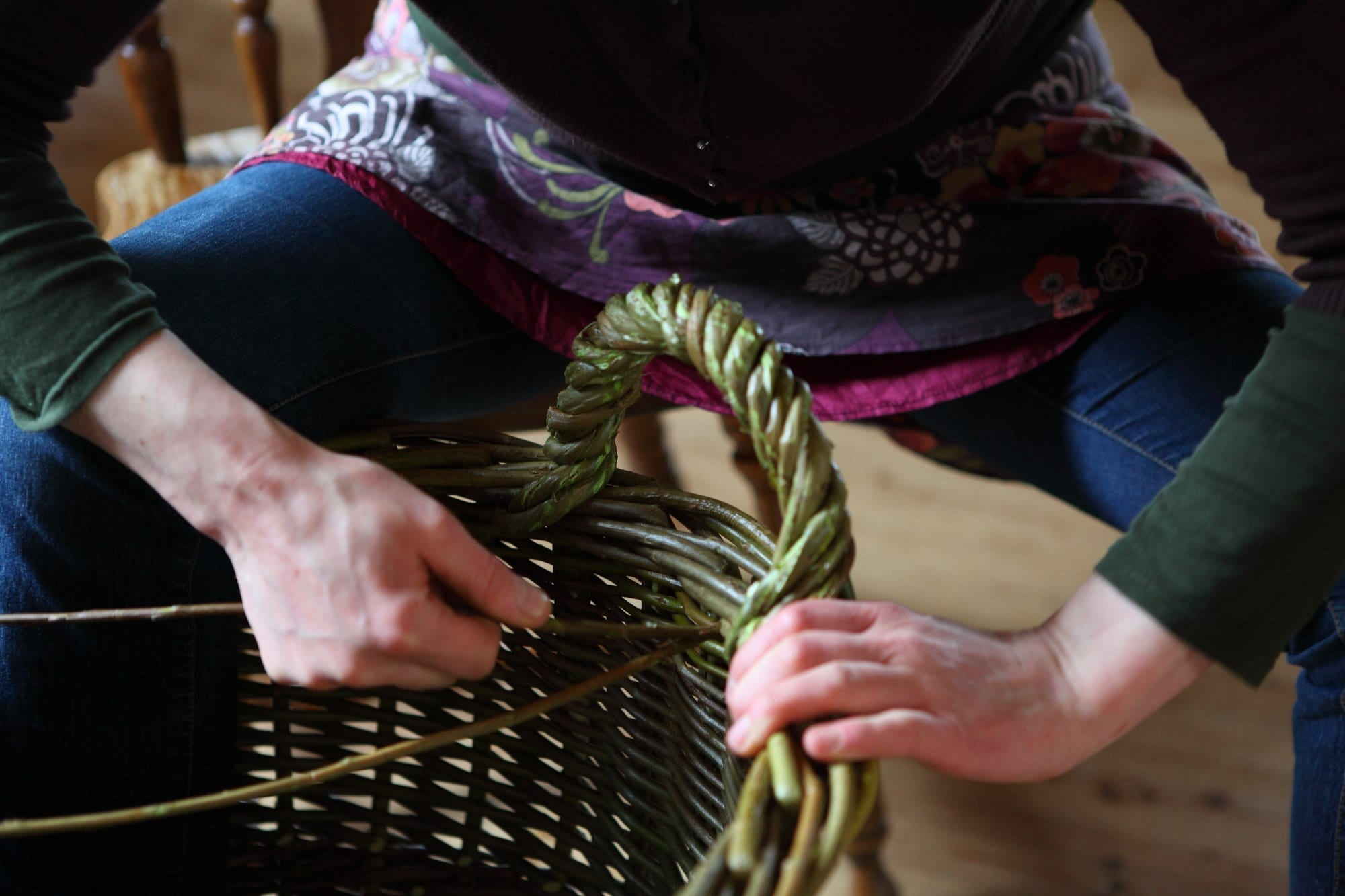 Hanna twisting a handle while making a basket