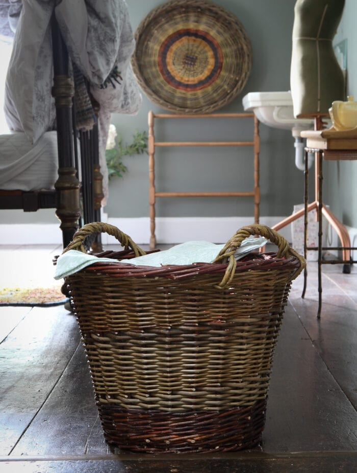 Large woven shopping basket with large skib hanging as wall decor