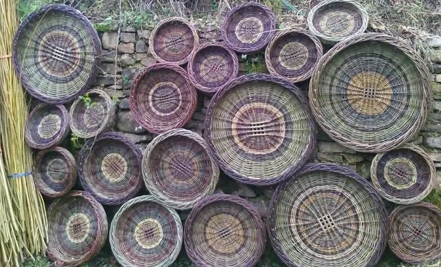 Multiple skib baskets hanging on a wall as decor, image 2